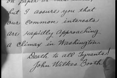 Close-up historical recreation of letter written by John Wilkes Booth stock video footage