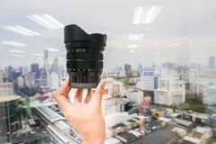 Close up hold camera lens in hand. For taking photograph Stock Photo
