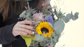 Close-up, holding a bouquet of flowers on a winter day stock video