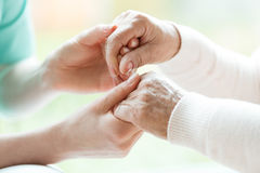 Close-up of holding hands stock photos