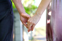 Close-up Holding Hands with Wedding Ring Stock Images