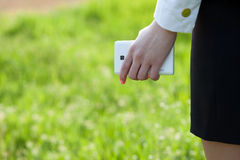Close up of holding smartphone Stock Photo