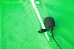 Close-up of  holding a Wireless lavalier microphone. Royalty Free Stock Photos