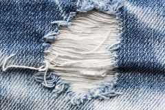 Close up of hole on shabby denim or jeans clothes Royalty Free Stock Image