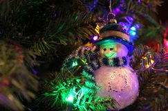 Snowman Ornament on Christmas Tree. Close Up of Holiday Decorations stock photo
