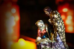 Close up holy family with decorative light blurry background. royalty free stock image
