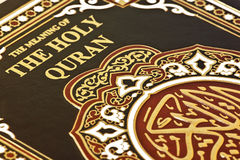 Close-up of the holy quran. Close-up of the Islamic book The Holy Quran Stock Photos
