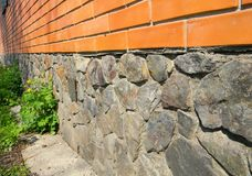 Close up on house foundation wall from wild stone waterproofing with bitumen membrane. stock images