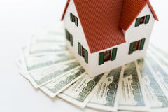 Close up of home or house model and money Royalty Free Stock Photo
