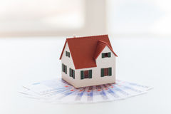 Close up of home or house model and money Stock Images
