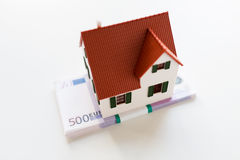 Close up of home or house model and money Stock Photography