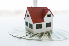 Close up of home or house model and money Royalty Free Stock Images