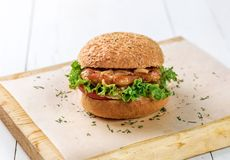 Close-up of home made burger on wooden board royalty free stock photo