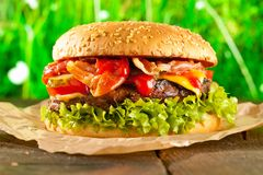 Close-up of home made burgers with fire flames royalty free stock photo