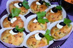 Close up of Home made  cheese muffins    with  herbs and olives Stock Photos