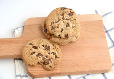 Close up of home made chocolate chip cookies on a wooden plate Stock Photos