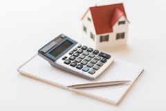 Close up of home model, calculator and notebook Stock Images