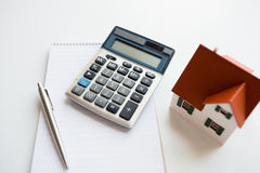 Close up of home model, calculator and notebook Stock Photography