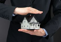 Close up of home model on hands. Concept of real estate and construction Stock Images