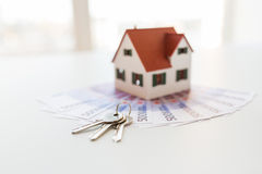 Close up of home model, money and house keys Stock Photography