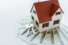Close up of home model, money and house keys Stock Photos