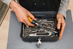 Close up. Home renovation tool kit. The repairman is holding an open toolbar