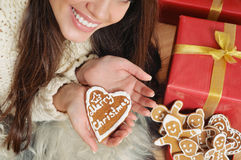 Close up home sweet cookie for Christmas in hand Stock Image