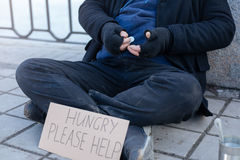 Close up of homeless person keeping money in right hand Royalty Free Stock Image