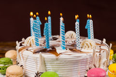 Close up of homemade birthday cake with lots of burning candles Stock Images