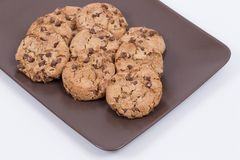 Close up of homemade cookies on a brown ceramic platter royalty free stock image