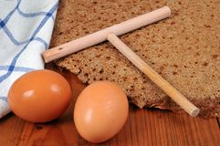 Close-up homemade galette with eggs and a wooden squeegee royalty free stock photo