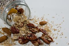 Homemade granola spilling from jar Royalty Free Stock Images