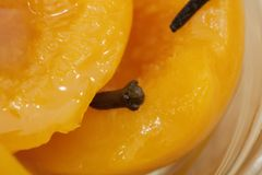 Close up of homemade peach compote spiced with cloves, used for making peach liqueur stock photography