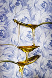 Close up of honey dripping from spoons Royalty Free Stock Photos