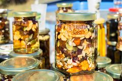Close Up Honey Jar Packed With Pumpkin Seeds Walnuts Almonds Fig. S And Other Nuts And Dried Fruits Turkish And Arabic Traditional Desserts Royalty Free Stock Photo