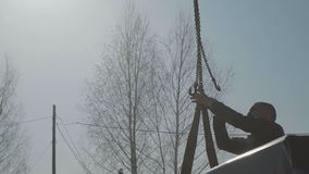 Close-up of the hook of a crane against the blue sky. Crane transport stock footage