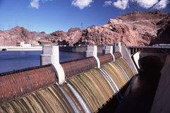 Close Up of Hoover Dam Spillway. Hoover Dam massive spillway entrance with Lake Mead, mountains and blue sky in background Stock Photography