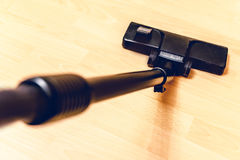 Close up of hoover or vacuum cleaner cleaning floor at home, housework Stock Image