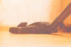 Close up of hoover or vacuum cleaner on floor at home, housework and cleaning Stock Image