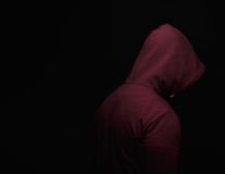 Close-up of hopeless narcomaniac going through the addiction crisis. A guy in the hood turned away. Copy space. Royalty Free Stock Photo