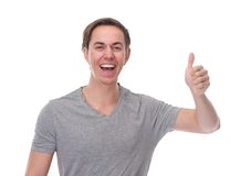Close up horizontal portrait of a happy man smiling with thumbs up Stock Photo