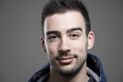 Close up horizontal portrait of young unshaven man wearing hoodie Stock Photo