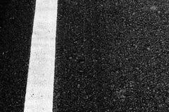 Close-up horizontale mening van de wegachtergrond van de asfalttextuur stock afbeeldingen