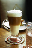 Close up hot cappuccino. In long glass Royalty Free Stock Image