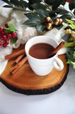 Close up Hot Chocolate Cup. With cinnamon stick on wooden board stock photos
