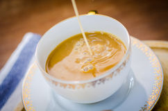 Close up of hot coffee in ceramic mug Royalty Free Stock Photography