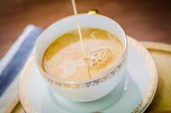 Close up of hot coffee in ceramic mug Stock Images