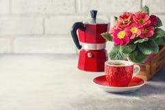 Close-up of hot coffee, moka-pot and flowers. Stock Photos