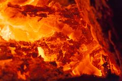 Close up on hot fireplace burning. Macro Royalty Free Stock Photos