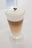 Close up of hot frothy latte. At the coffee shop Stock Images